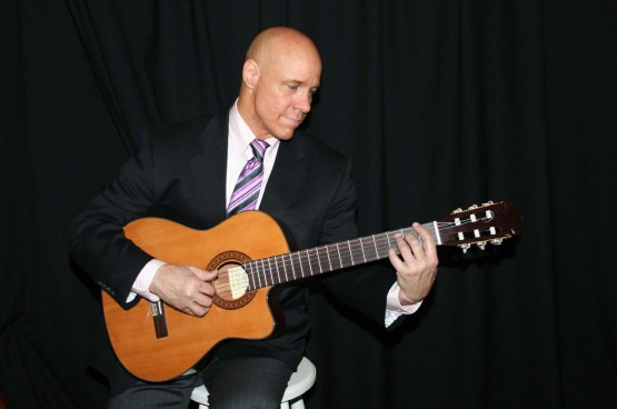Reggies In Suit W Guitar 009_for welcome article_replacement